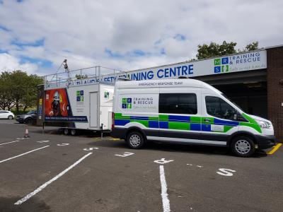 A mobile training unit and MRS Training & Rescue van outside of the Crossgates training centre