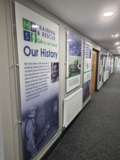 Historical Timeline of MRS Training & Rescue on a wall