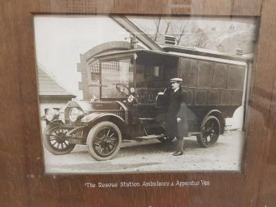 A man stood next to an apparatus van in 1912