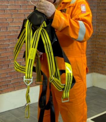 Untangle any webbing on the safety harness